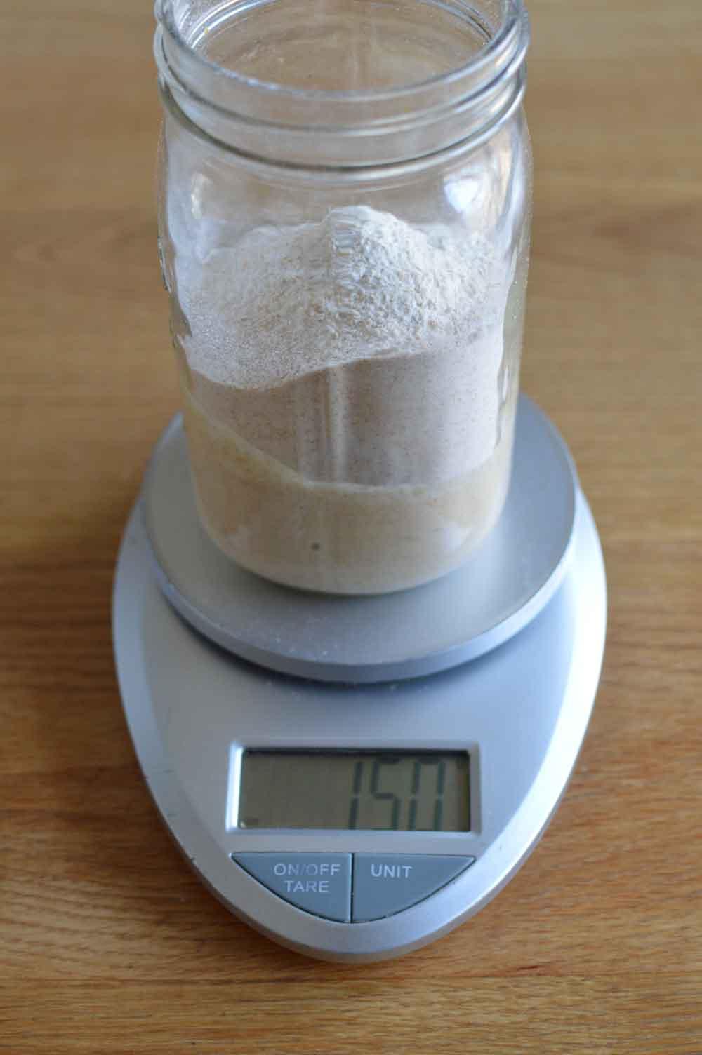 Adding-flour-to-feed-Sourdough-Starter.jpg