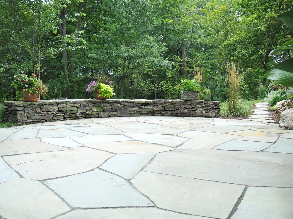 Flagstone patio with reataining wall in Vermont