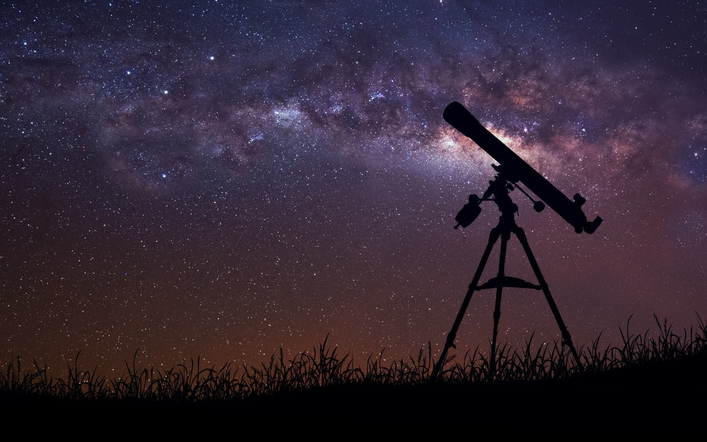 infinite-space-background-with-silhouette-of-telescope.jpg