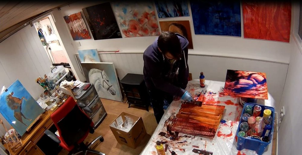 In the studio working on a set of abstracts painted on aluminum panels for an interior design project.