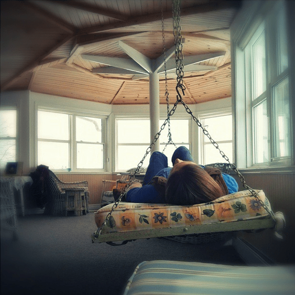 Danettes-shot-of-Britt-on-the-bed-swing.png