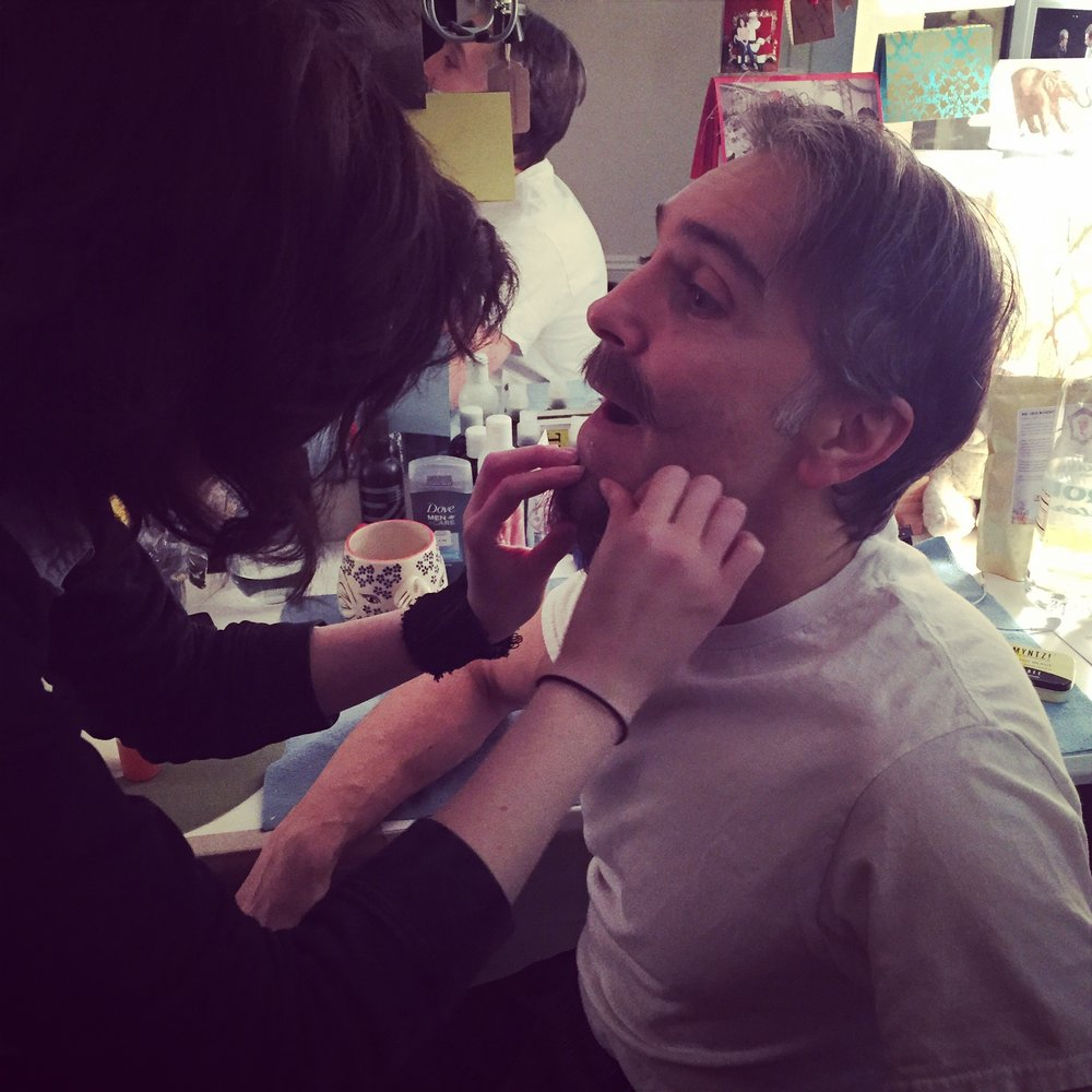 "Wig Guru Jamie Amadio applies ""Lord John's"" beard"