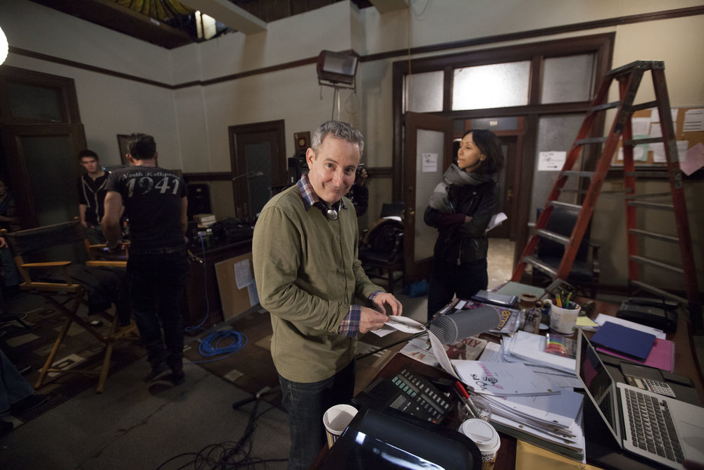 "1/16/16 Cops & Bottoms Production Office Scene. L to R: Eddie Jemison (""Chaim""), Linda Park (""Jennifer"")"