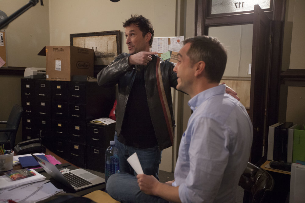 "1/16/16 Cops & Bottoms Production Office Scene. L to R: Noah Wyle (""Noah""), Scott Lowell"
