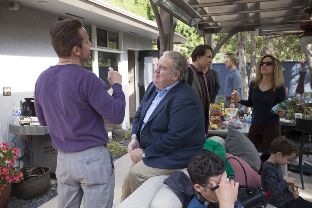 "1/17/16 Garden Party Scene. L to R: Gus Buktenica (""Declan""), Jim O'Heir (""Bob Raskin""), Party Guests Mark Dakich & Laura Lamson"