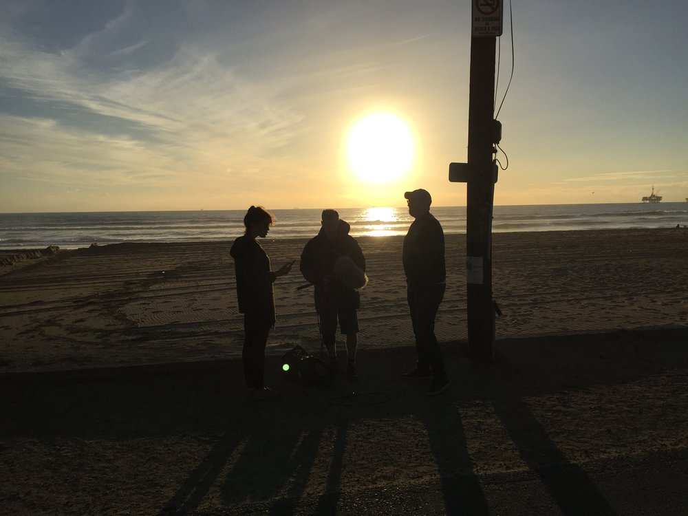 "12/13/15 Sunset Beach Scene Scene. L to R: Emily Swallow (""Lisa""), Eddie Jemison (""Chaim""), Jeff Rosenthal (Exec. Prod.)"