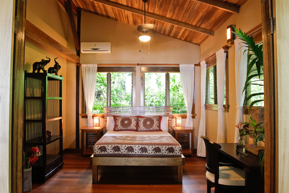 Seasonal Villas - The villa is a short 100 yard stroll from the beach, set in the heart of a tropical paradise. It features 1000 sq. ft, on two levels with polished teak floors, soaring ceilings, gorgeous furnishings, thoughtful details, and ocean and rainforest views.