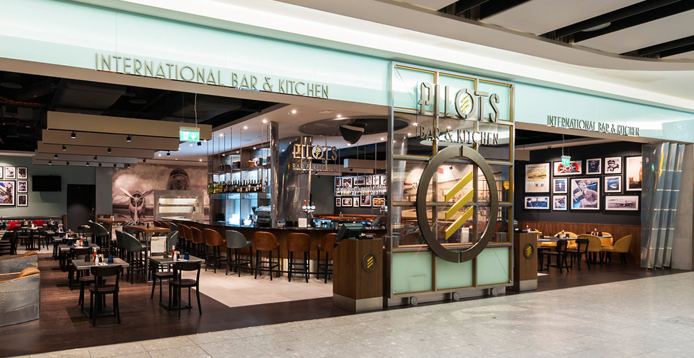 Pilots Bar & Kitchen,   Heathrow T5   Nestled amongst the luxury brands, Louis Vuitton, Tiffany, Fortnum & Mason, Rolex etc, Pilots Bar & Kitchen celebrates the post-war golden age of international travel.