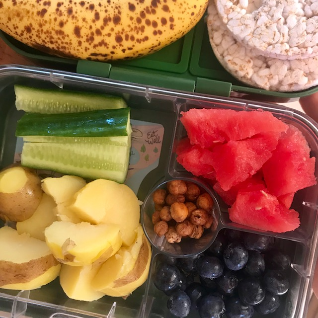 steamed potato, roasted chickpeas, blue berries, cucumber, watermelon, banana, rice cakes. -