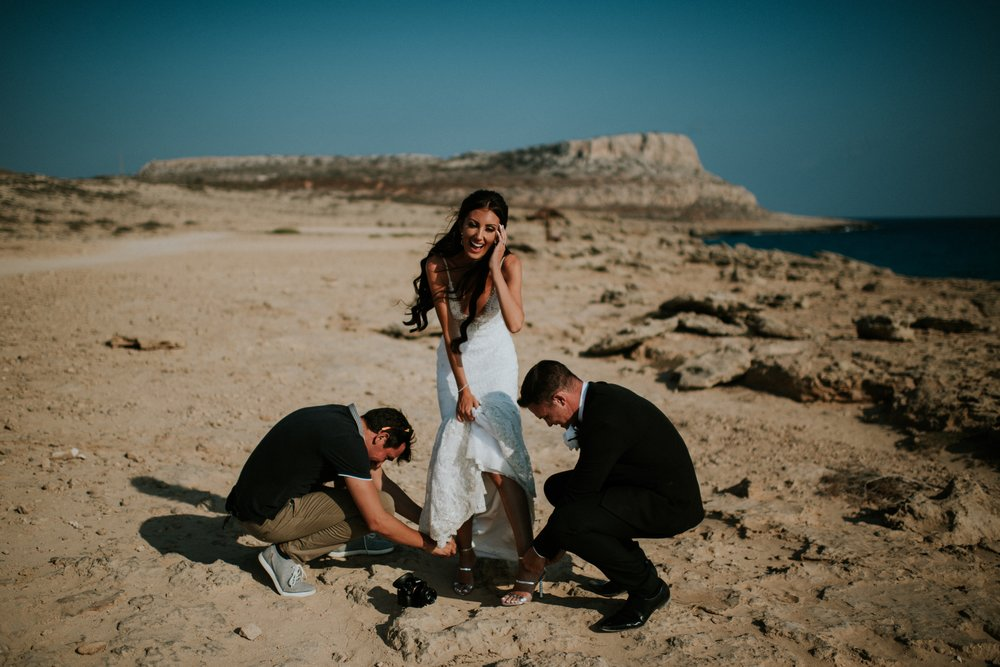 BTS - Alex from Red Lens Films along with Alan, helping me with my shoes!