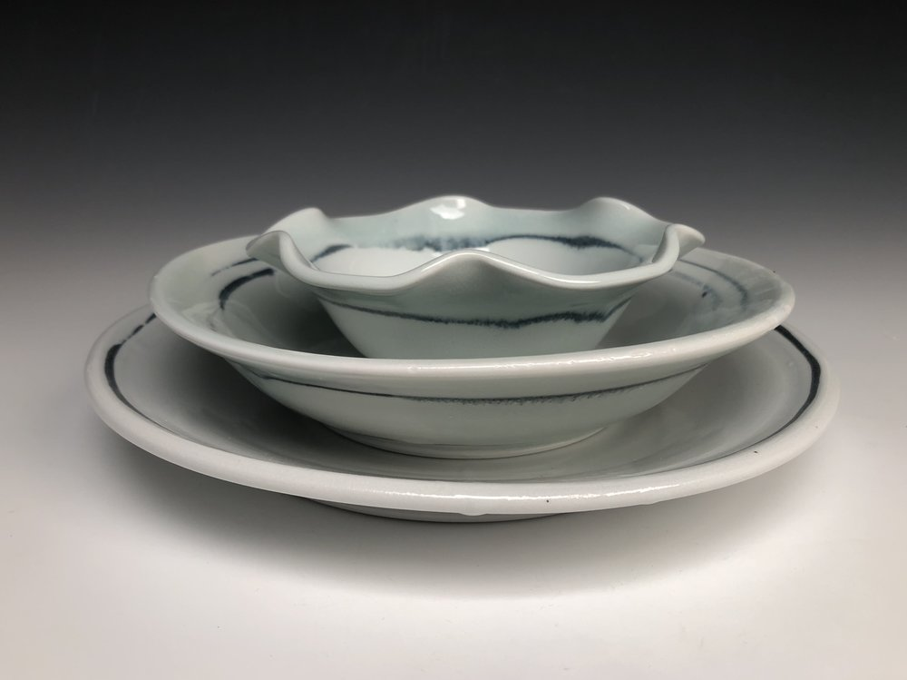 Stacked dinner plate, pasta bowl, and side or dessert bowl. Smaller bowls are 5 inches across.