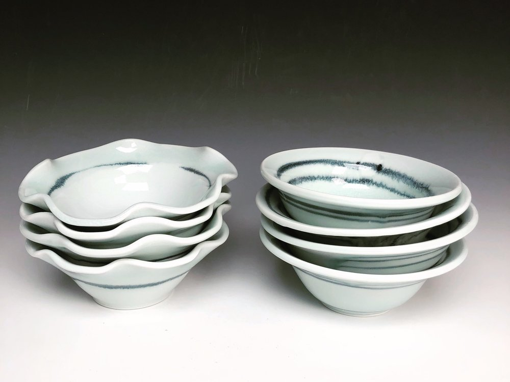 5-6 inch dessert bowls or side dishes. A kitchen must! Perfect for just about everything from fresh fruit, ice cream, olives, nuts, rice…. any and all side dishes you can imagine! White with a celadon green rim to enhance the movement of deep blue black line.