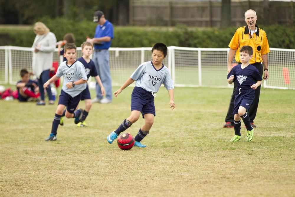 Boys Soccer with Ref.jpg
