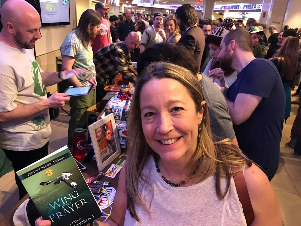 A fan spots the Eco-Adventure Series at a Waterwheel Foundation booth at a Phish concert