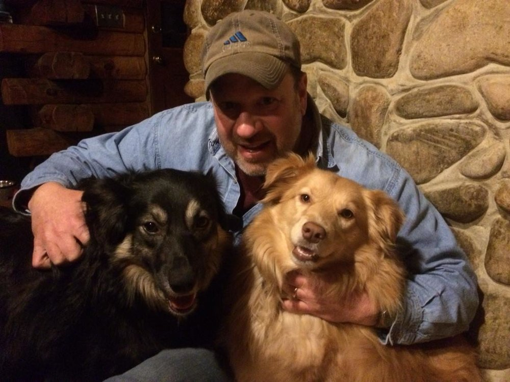 John Morano at home with his rescued Australian Shepherds