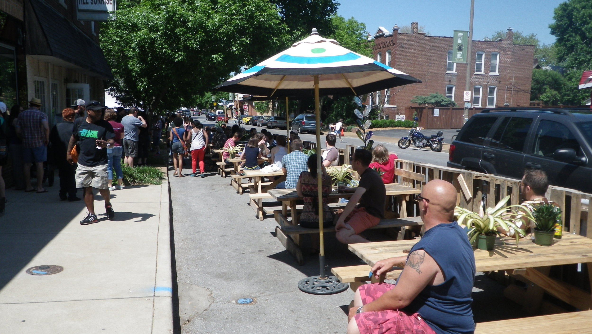 At the Better Block event, sidewalks were widened to slow traffic and provide more outdoor patio space.