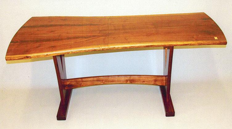 Trestle dining table, live-edge walnut.
