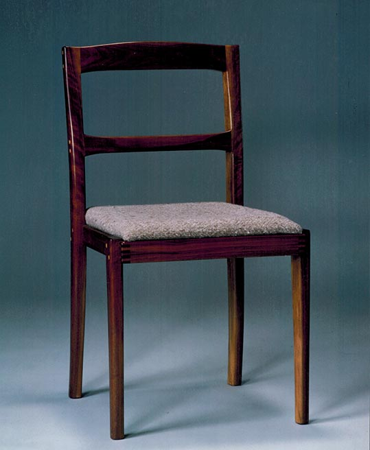 Upholstered dining chair, walnut.
