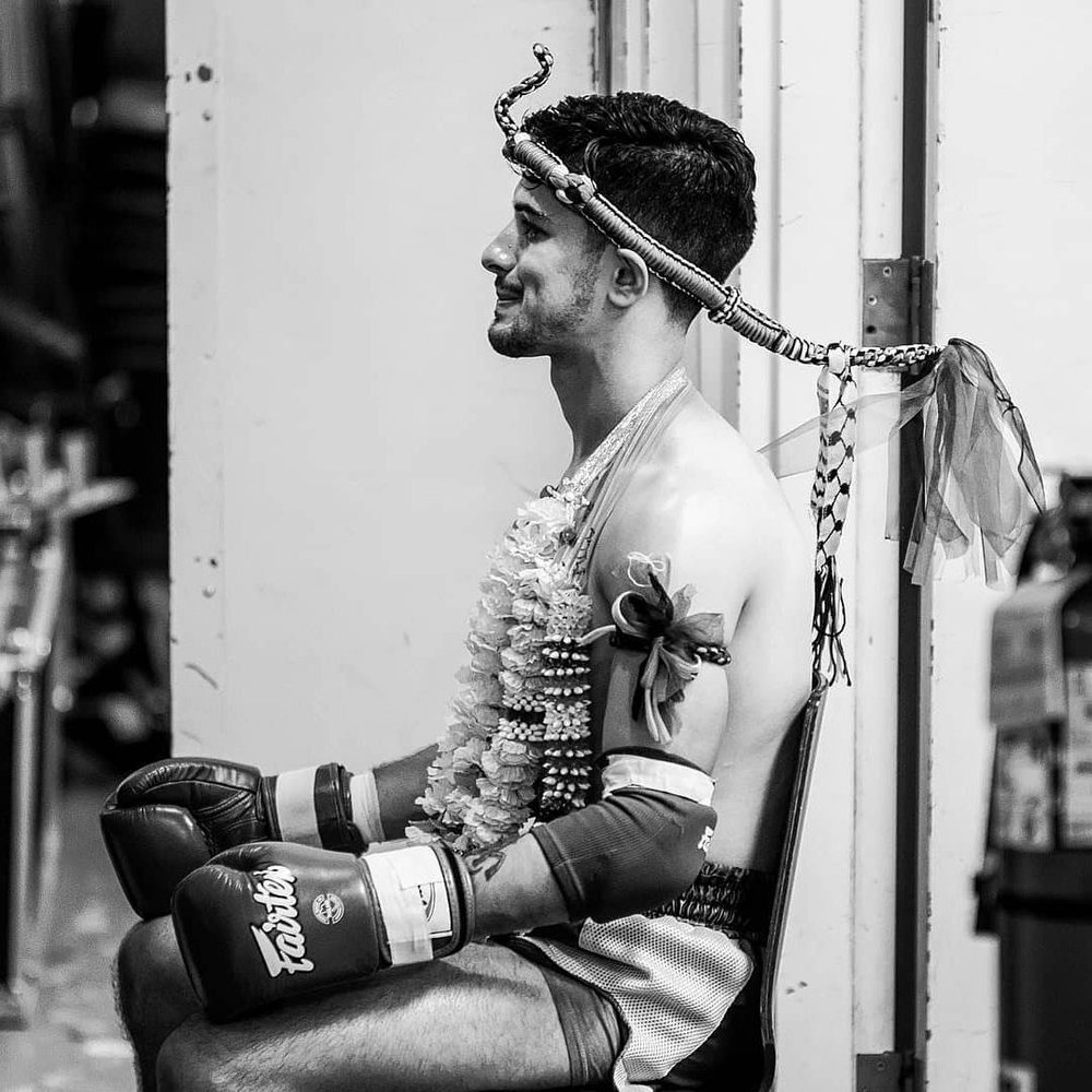 Muay Thai is steeped in ritual with fighters wearing a 'Mongkon', a traditional head piece given to them by their trainers. Prior to fights, fighters 'seal the ring' to protect themselves from bad spirits and to pay their respects to their trainers, gym, and family.