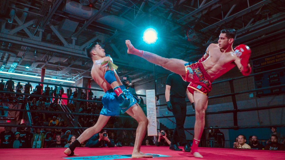 George slipping a head kick. He would go on to lose this fight in a hard fought and closely contested unanimous decision.