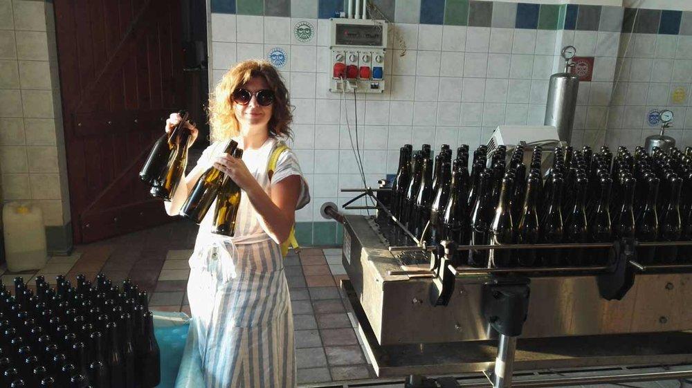 amanda helping to bottle wine