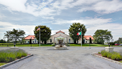 Raphael WInery_entrance to tasting room and circluar parking with flags.jpg