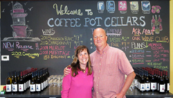 CoffeePotCellars_owners chalk board and wine_.jpg