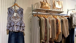 Mint_shirt rack and pocketbooks for sale.jpg
