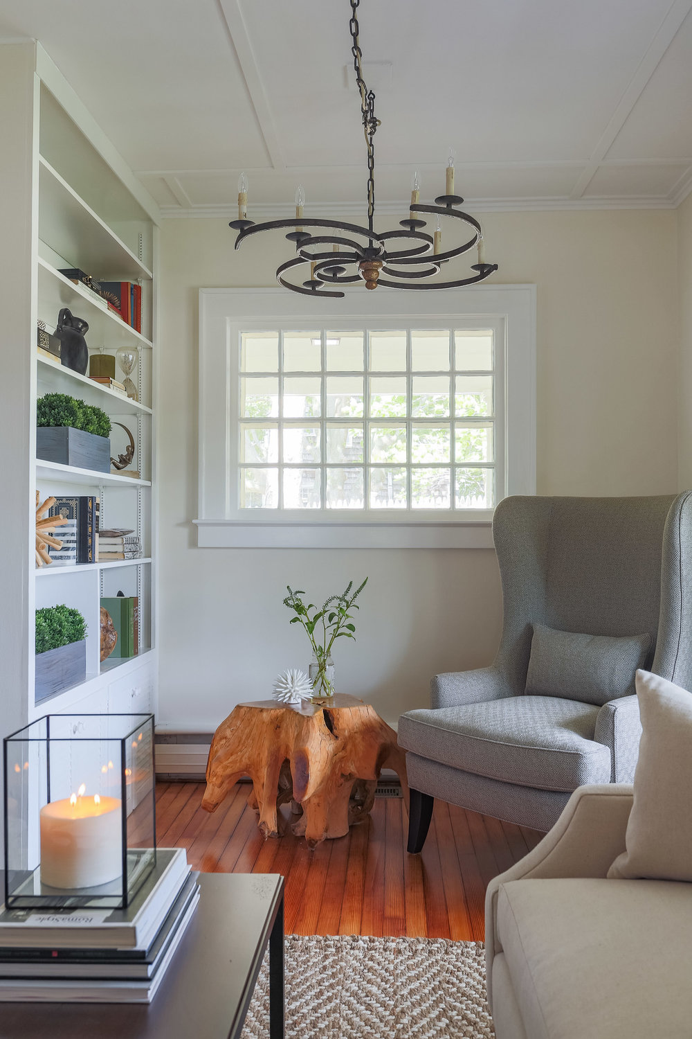 Cozy reading nook bookcase rustic chandelier teak.jpg