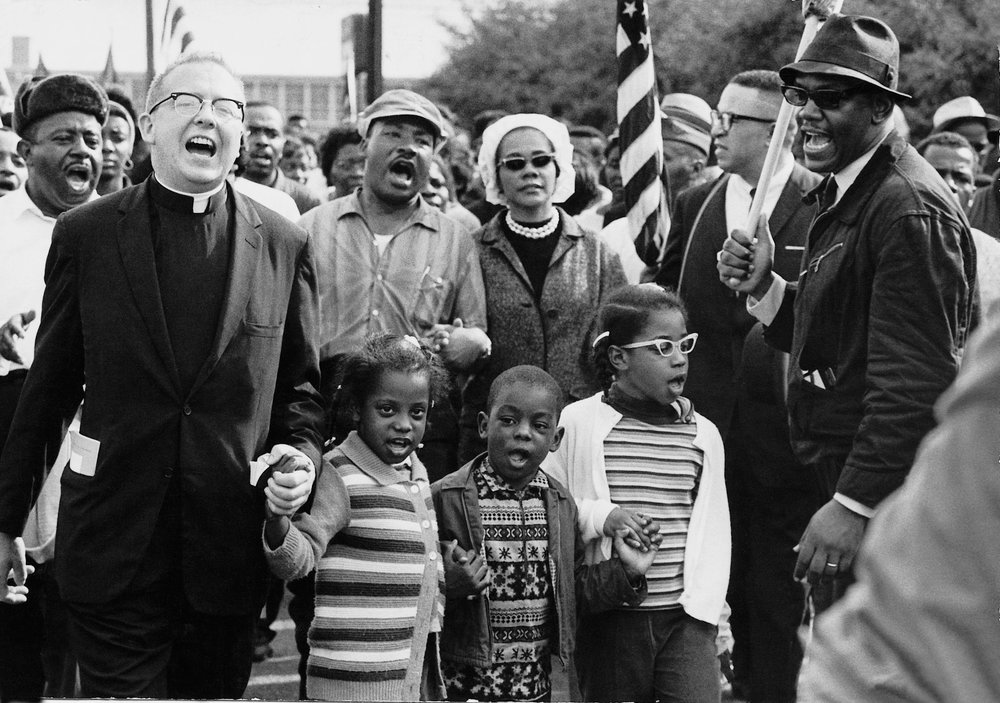 The Selma, Alabama-Montgomery, Alabama March for Voting Rights for African-Americans in March 1965 drew interdenominational and interracial supporters. The Rev. Dr. Martin Luther King. Jr. and his wife Coretta Scott King are in the middle, Rev. Ralph Abernathy to the left of them, and Abernathy's children in front. As the marchers left Selma, Alabama state troopers and local police attacked the protesters with billy clubs, tear gas, fire hoses and dogs. It awoke the nation and led to the passage of the Voting Rights Act of 1965
