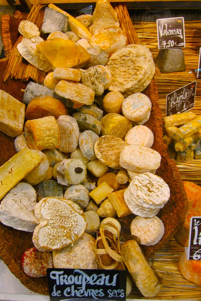 "Parisian market display. ""How is it possible to run a country which has 246 varieties of cheese?"" -Charles de Gaulle"
