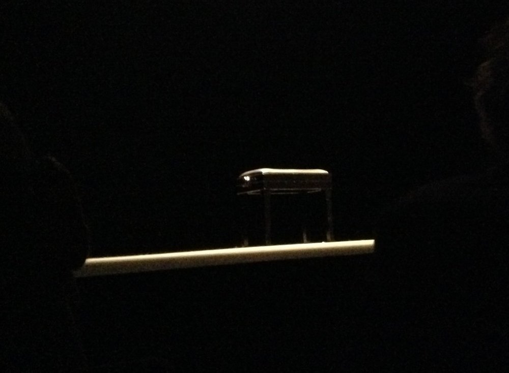 A single bench and spotlight on stage illuminated a darkened hall for a full five minutes before each piece, inviting silence and anticipation