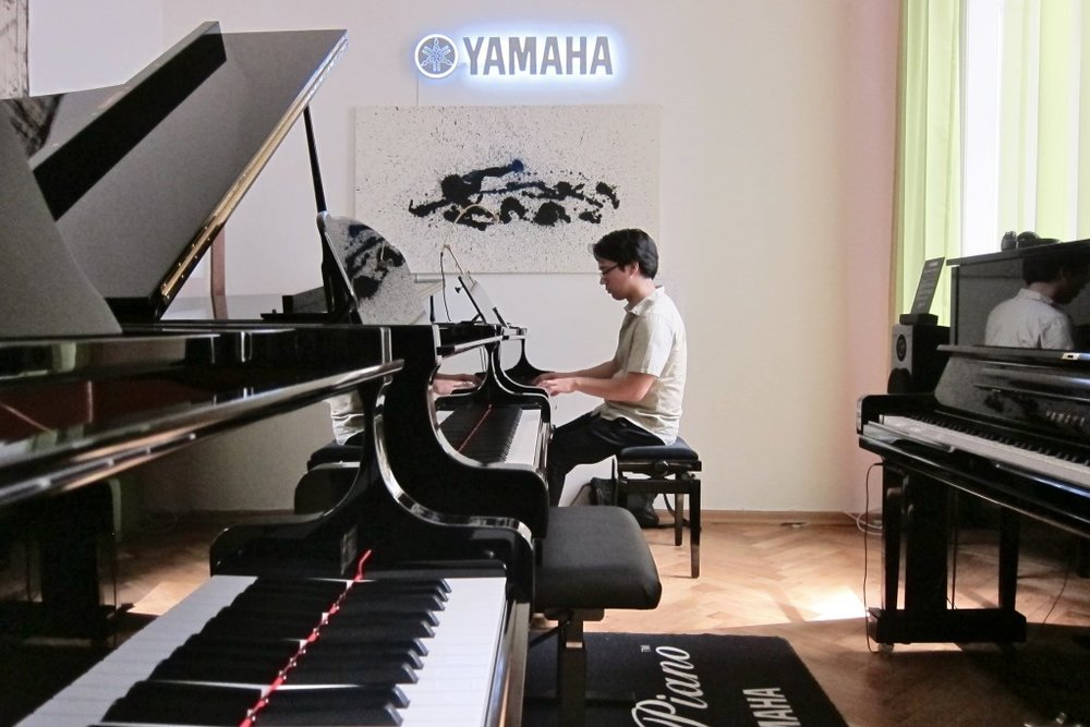 Rehearsals in a Yamaha showroom