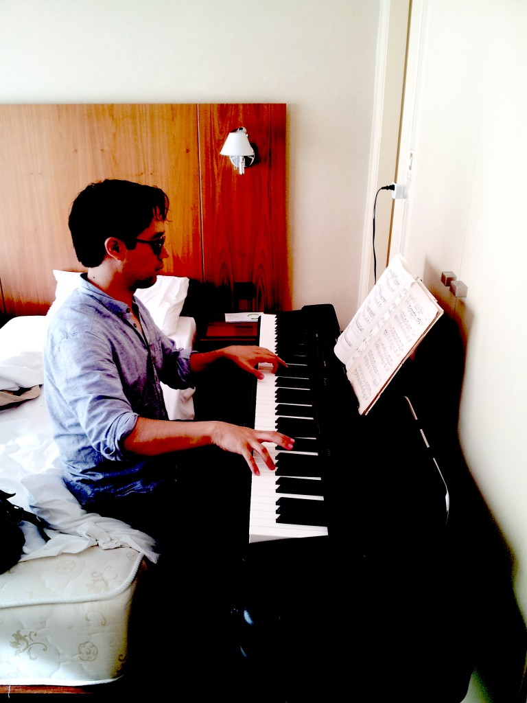 An odd place to practice Schumann in Athens–wrong height from bed to piano–too much of this arm position would injure a pianist. My teacher Bob Durso would be horrified. For some reason, there are sunglasses on while practicing.