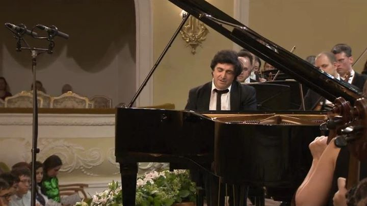Sergei Babayan plays an encore after a concerto performance with Valery Gergiev in Moscow, 2012.