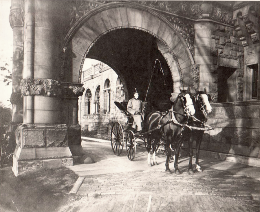 The full-livery carriage in the entrance of the 40,000 sq.-ft. mansion of Sylvester Everett.