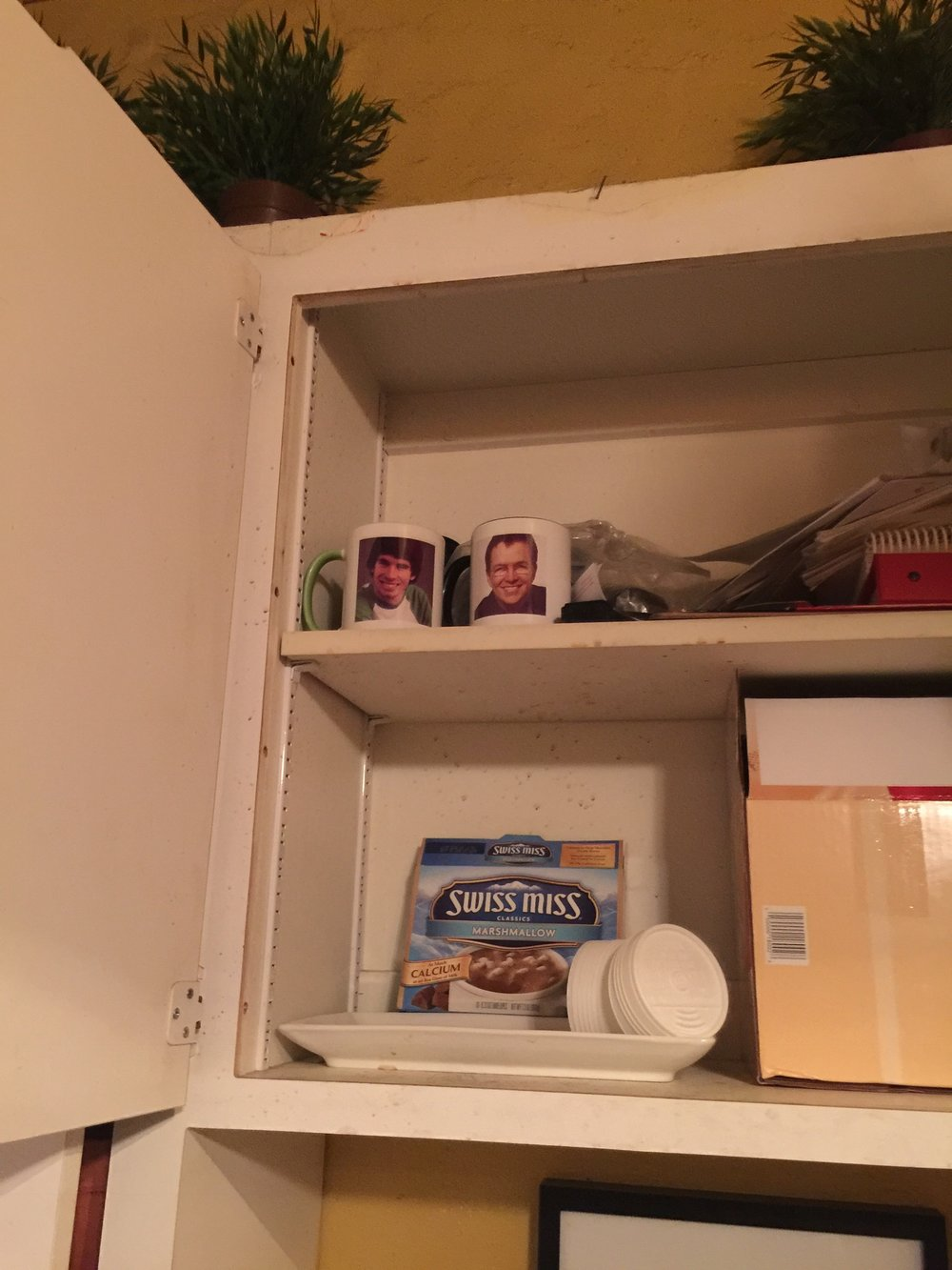Our audition mugs safe on their shelf at The Lounge Theatre!