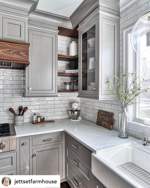 #funfriday is here! Seriously loving these gray cabinets with wood accents..and don't get me started on my love for a farmhouse sink! #swoon . . #kitchenenvy #kitchendesign #kitchenremodel #kitchencabinets #kitcheninspiration #kitchensofinstagram #dreamkitchen #farmhousesink #graycabinets #subwaytile #azhomes #homesforsale #phoenixrealtor #scottsdalerealtor #madisonbustamante #design