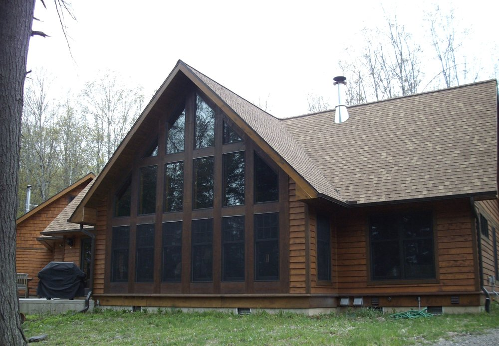 """Why a Cedar Home - • More Rot and Insect Resistant• Higher """"R"""" Factor• Less Shrinkage• Less Checking• More Natural Beauty• Higher Resale Value• Less Maintenance"""