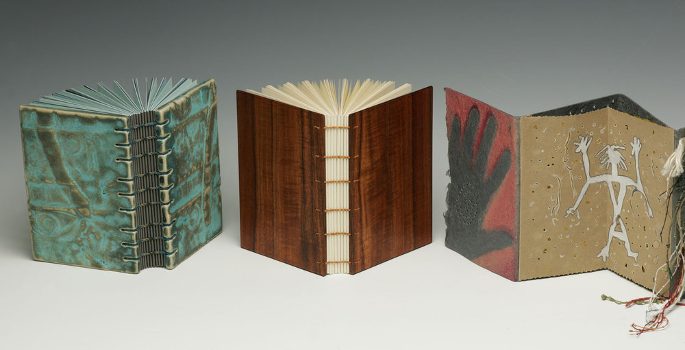 Two Coptic-sewn bindings and accordion pages represent cave paintings and petroglyphs
