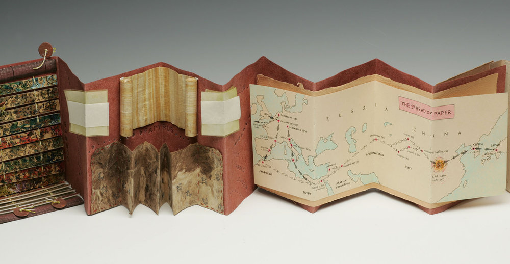 Early writing substrates: papyrus, bark paper and vellum. A map shows the invention of paper in China and how it began to spread throughout the world.