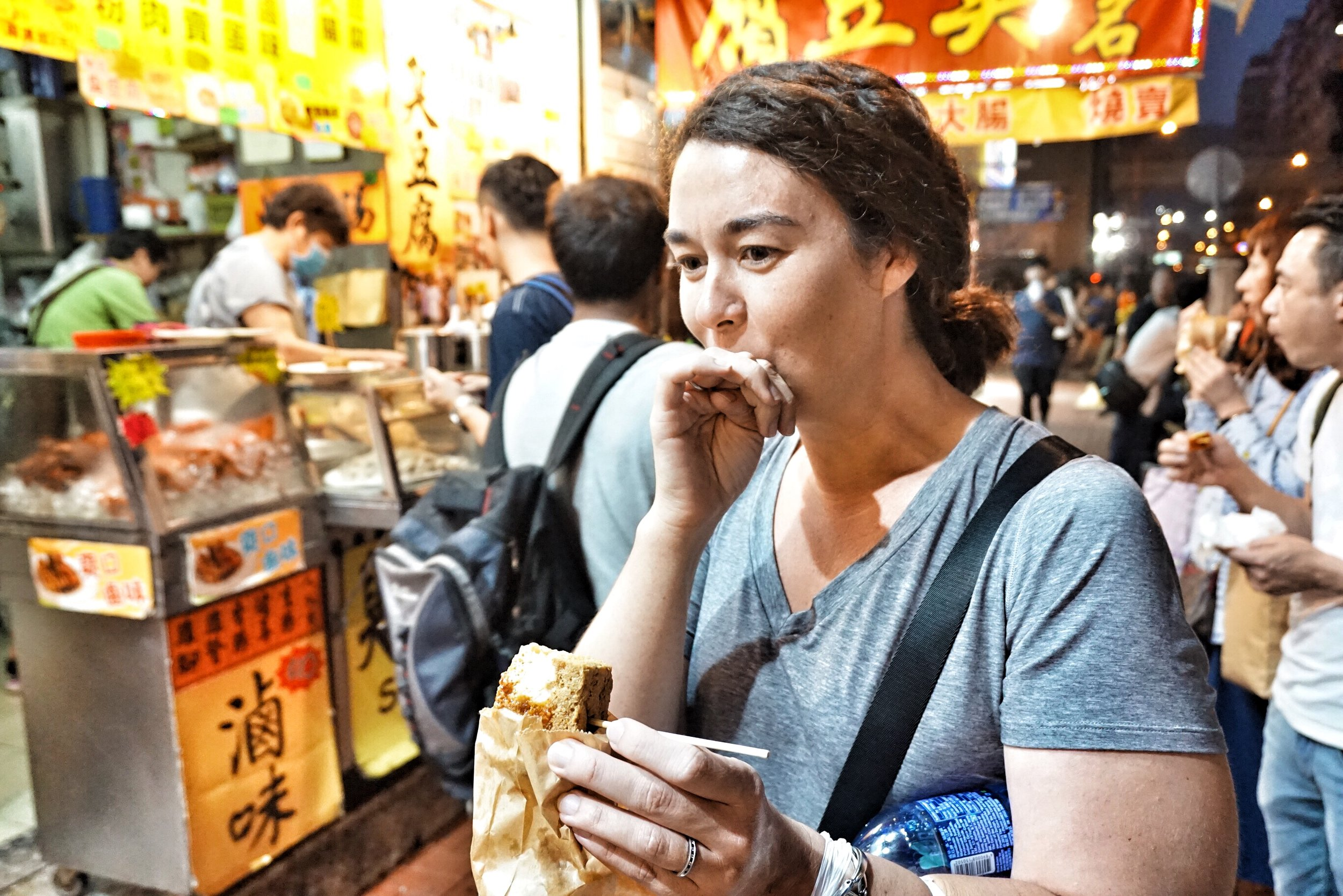 Private tour guide Jess tries the stinky tofu during one of her night tours in Kowloon. The big question is, did she like it!?