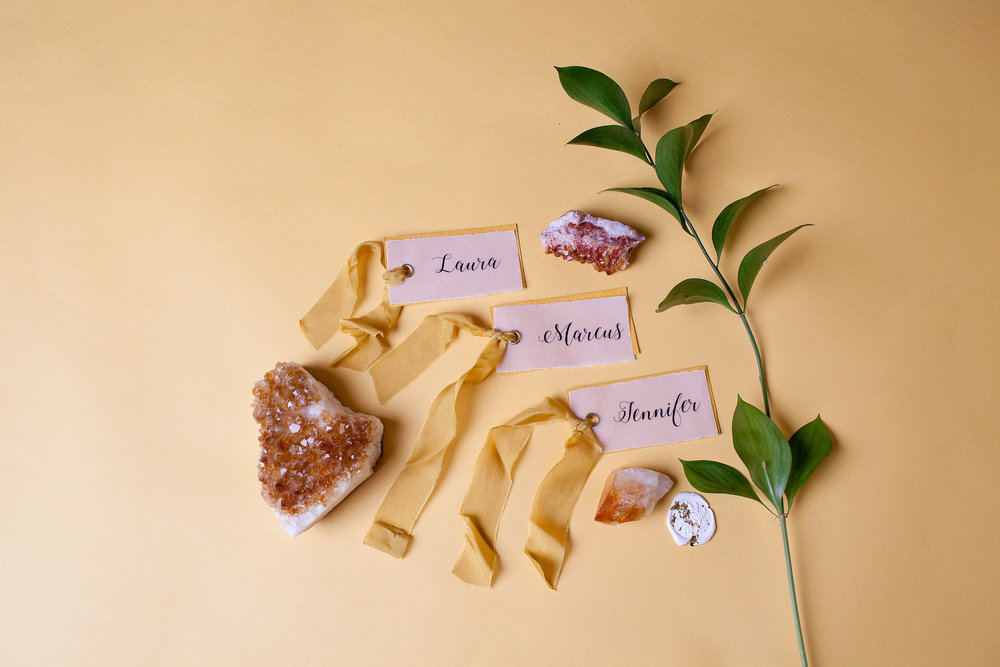 The Citrine Package - - 2 medium-large citrine geodes- 5 medium-small citrine geodes- 2 small citrine pointsPrice to hire: £35 (Not including delivery)(Image by Fairweather Photography, stationery by Mama Inc Studio)