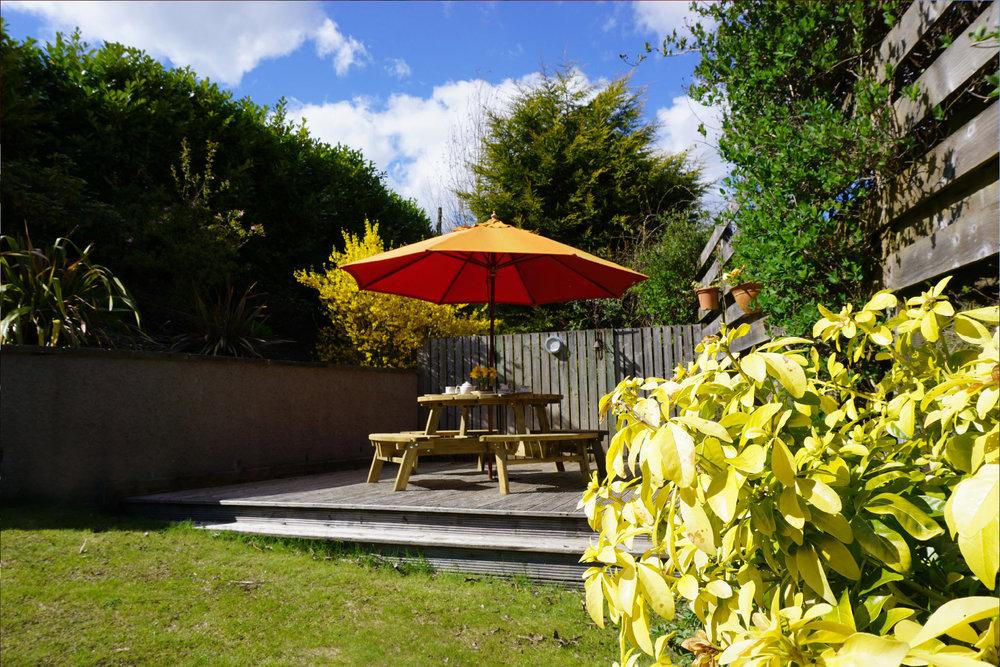 Garden deck with picnic bench