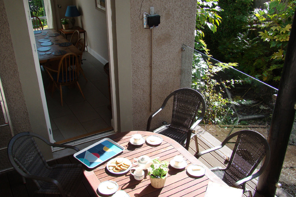 Sunny, sheltered deck from dining room
