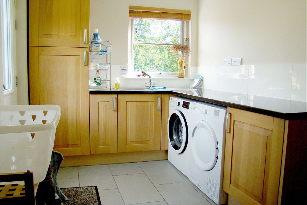 The generous utility room is well equipped