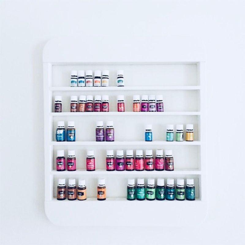 Various essential oils on a white shelf