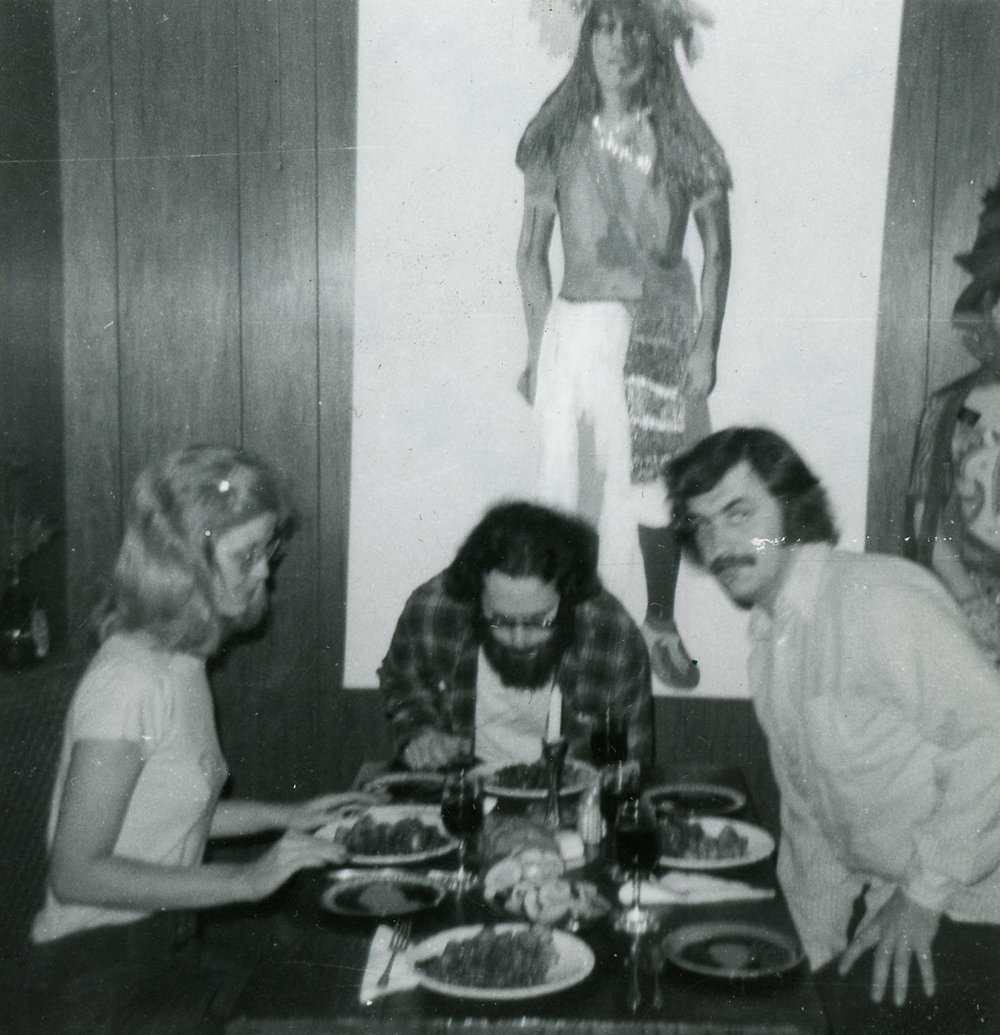 Carla, Tom and Mike sit down for dinner, c. 1970.