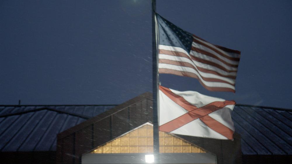 60_WRESTLE_American and Alabama flags outside Huntsville Junvellie Dentention Home.jpg