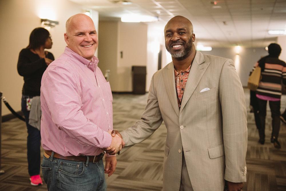 Rick Phillips, CEO of Spotlight Cinemas and Bishop Eric J. Freeman